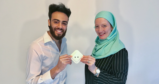 Ahmed Maher and Maja Maher, the respective CEOs of DiamondV and Nova Institute, holding one of their fever detection devices.